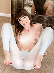 Slender Nubile stuffs her tight twat with a big dildo