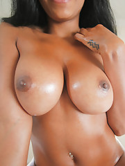 Horny black chick gets her big black tits covered in hot jizz