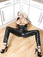 This sexy black latex catsuit looks absolutely Purr-fect on hot blonde babe Dannii