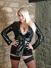 Cute blonde Dannii Harwood is dressed in this very kinky short and shiny black leather