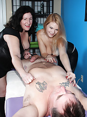 Mom and daughter squeeze his balls and painfully jerk his cock.
