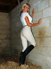 Lucy Zara is dressed as a sexy stable lass on the farm in her jodhpurs and riding