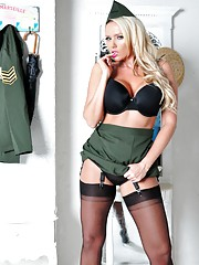 Hot Milf Lucy Zara is dressed up as a sexy French army officer who enjoys revealing