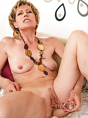 57 year old Georgina C ramming a large dildo into her mature hole