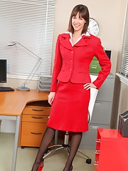 Carole relaxes after a hard day in the office by stripping out of her red skirt suit