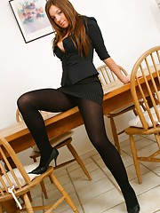 Sophisticated secretary in sexy thick black pantyhose