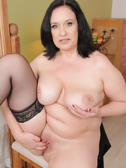 Elegant 48 year old Ria Black stuffs her pussy with a big black dong