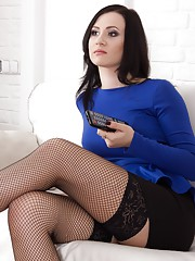 Kaira is only 21 and poses seductively in her blue blouse black skirt and stockings.