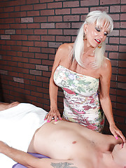 Busty mature babe stroking big cock till it explode with cum