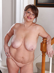 48 year old Penny Beavers stuffs her large tits into the stair railings
