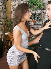 Jynx Maze is a married Latina waiting for her husband. The bartender is also married