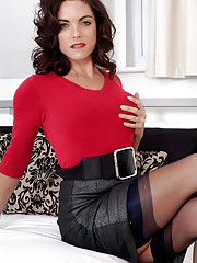 Sweater girl Rebekah teases and strips down to corselette and nylons