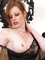 Redhead Holly teases and dildo pleases in black nylon slip sheer panties and French