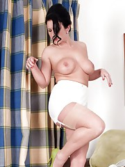 Busty Ashleigh our girdle girl teasing with almost transparent seamed nylons..