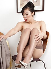 Tigerr alone at her table in fully fashioned stockings.
