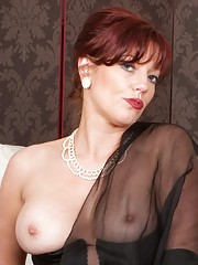 Sophisticated redhead Holly in black lingerie and ff nylons!