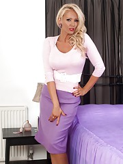 Lucy Zara strips and masturbates in glossy nylons on the bed!