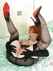 Red teases in vintage corselette black fully fashioned nylons and heels!