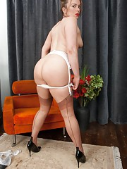 Debutante Emma Louise making a nylonic impression in her white lingerie and tan ff