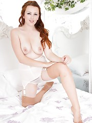 Jenny loved to watch herself playing on the bed in a mirror in her tan ff nylons!