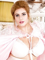 Cuddly blonde Ellie is ready for bed in her pretty lingerie ivory stockings and pink