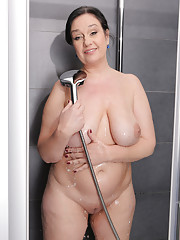 Big and busty Ria Black from AllOver30 getting herself wet in here