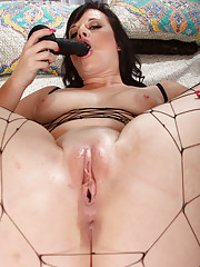 35 year old Virgo Peridot stuffs a black toy into her big moist pussy