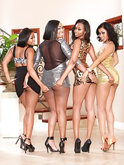 Four dressed up ebony babes love to pose and undress on camera
