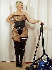 Kinky MILF in bodystocking and thigh boots hoovering