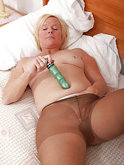 49 year old Sabine stuffing a large blue vibrator into her mature box