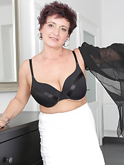 Beautiful 52 year old housewife Jessica Wild breaks from housework