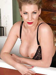 Danielle loves to bathe in nylons and finery and often has a splash of champagne