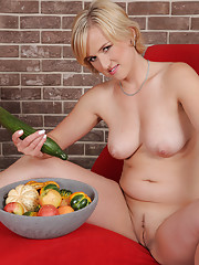 Blonde 30 year old Lu Berry toying her pussy with a long cucumber