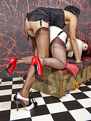 Two curvy girls slip into some sultry nylons and then have some strapon fun.