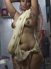 Lily in shower exposing her juicy breast in a wet see thru sari
