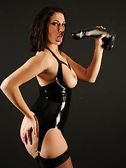 A sexy PVC outfit makes Paige look like a very dominant mistress and she knows how