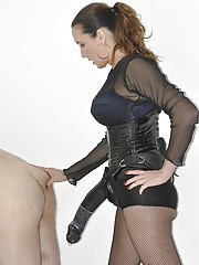 Strapon Jane fucks her submissives face with her strapon before unleashing the big