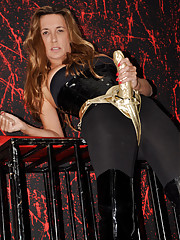 FemDom Jane poses with one of her huge golden strapons and looks fantastic.