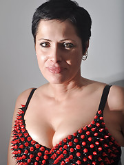 Short haired femdom posing with a big strapon
