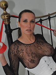 Femdom Jane shows off her great tits and big red strapon