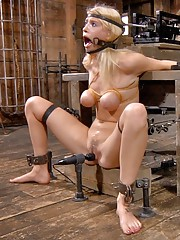 Allie James is locked into our Automatic-Blow-Job-Machine. Its a devious device designed