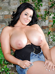 Karla James returns to the camera and pulls off her colorful bra
