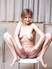 Attractive mommy strips down and teases her pretty pink twat