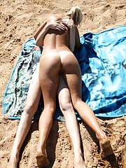 Two young girls on the beach start with licking and then..