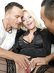 She handles two hard dicks like a real pro and loves it