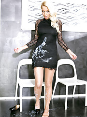 Her pretty black dress quickly becomes soaked with cum
