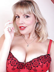Busty Danielle T looks ravishing in her lacy red lingerie