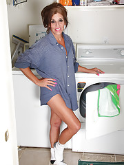 Naughty Nicole Newby doing her laundry and stripping down