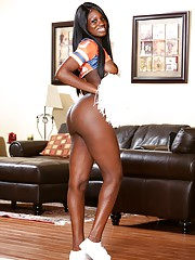 Stunning ebony babe Kay Love in a cheerleader outfit undresses