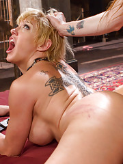 While left alone in the dungeon Bella Rossi escapes her bondage to spank flog cane